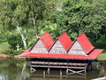 Water cottage lake house small easy with red roof tiles in a public park for rest and relax in bangkok thailand Stock Photos