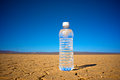 Water in the desert single clear glass of cold offers refreshment dry hot flat dusty Royalty Free Stock Photos
