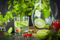 Water detox in a glass jar and a glass. Fresh green mint and berries. A refreshing and healthy drink. Royalty Free Stock Photo