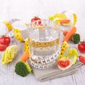 Water and dietetic vegetable Royalty Free Stock Photo