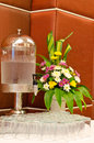 Water dispenser with glasses and flower vase at reception Royalty Free Stock Photo