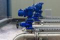 Water distribution industrial pipes and valves in process Stock Photo