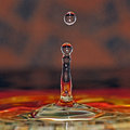 Water drop in beautiful colors and abstract splash Stock Images