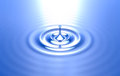 Pure water drop ripples blue background Royalty Free Stock Photo