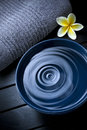Water drop a of in a ceramic bowl of with a flower and towel Royalty Free Stock Image
