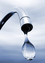 Water drop coming out of tap chrome shining Stock Photo