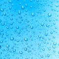Water droplets on a blue background Royalty Free Stock Photos