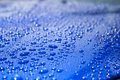 Water Droplets on Blue Car Hood Royalty Free Stock Photo