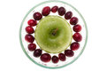 Water droplets on cranberries and apple, small bowl Royalty Free Stock Photo