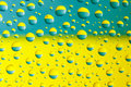 Water drops above ukrainian flag many colors blue and yellow Royalty Free Stock Photos