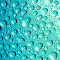 Water drops on blue background Royalty Free Stock Photo