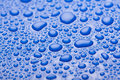 Water drops blue full frame closeup Royalty Free Stock Photography