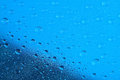Water drops on the blue surface. Selective focus. Royalty Free Stock Photo