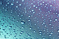 Water drops on a blue violet background close up Royalty Free Stock Photography