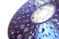 Water drops on compact disc Royalty Free Stock Images
