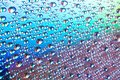Water drops on dvd media, water drops on colorful background Royalty Free Stock Photo