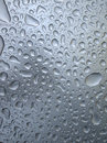 Water drops on glass Stock Images