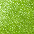 Water drops on green glass in the background Stock Photo