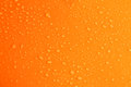 Water drops on orange background, close up Royalty Free Stock Photo