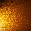 Water drops on orange beer background. Royalty Free Stock Photo