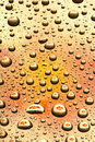 Water drops on orange glass Royalty Free Stock Photography