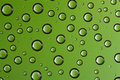 Water drops over green background Royalty Free Stock Photography