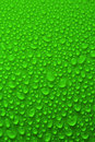 Water drops over green background Stock Photos