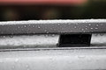 Water drops on roof rack are hanging the foof after rain Royalty Free Stock Photo