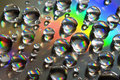 Water Drops with thick rainbow line Stock Photo