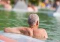 Water enjoyment senior man enjoying in swimming pool with hot Royalty Free Stock Photography