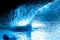 Water explosion beautiful splash of blue to drink Royalty Free Stock Photo