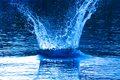 Water explosion beautiful splash of blue to drink Royalty Free Stock Photography
