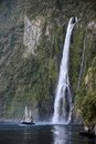 Water fall and boat in the Milford Sound Royalty Free Stock Photo