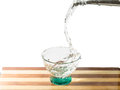 Water falling into glass on cutting board Royalty Free Stock Photo