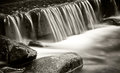 Water falls in a small river. Royalty Free Stock Photo