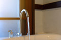Water from faucet to bathtub Royalty Free Stock Photo
