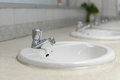 Water faucet with washbasin in bathroom stock photo Royalty Free Stock Photo