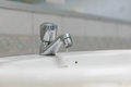 Water faucet with washbasin in bathroom stock photo Royalty Free Stock Images