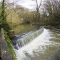 Water flowering over weir scenic view of in oldbury court estate bristol england Royalty Free Stock Image