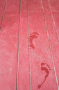 Water footprint on maroon wooden floor Royalty Free Stock Photo