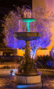 Water fountain lit by colorful lights central plaza of zaruma ecuador Royalty Free Stock Photography