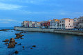 Water front syracuse sicily italy the waterfront in the mediterranean sea with houses and rocks in the in the evening in Stock Images