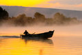 Water fumes and lake fisherman start of work fishing Royalty Free Stock Photography