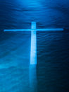 Water ghost cross white like on dark blue Stock Photos