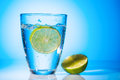 Water glass and lime a of fresh drinking a mineral as a thirst quencher Royalty Free Stock Images