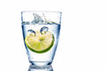 Water glass and lime a of fresh drinking a mineral as a thirst quencher Stock Photos