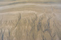 Water grooves in sand the at donna paula beach goa Royalty Free Stock Photo