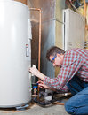 Water heater maintenance a plumber is performing on a residential Royalty Free Stock Image