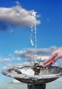 Water hose gushing from a over blue sky Stock Photo