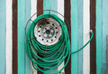 Water hose hang on the wooden wall outdoor Royalty Free Stock Photo